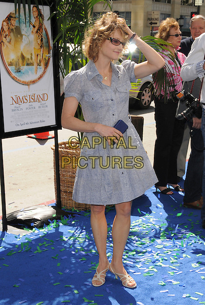 JODIE FOSTER .Attends Fox Walden's World Premiere of Nim's Island held at The Grauman's Chinese Theatre in Hollywood, California, USA, March 30th 2008                                                                     full length blue grey gray dress shirt hand on hair head sandals clutch bag sunglasses shades.CAP/DVS.©Debbie VanStory/Capital Pictures