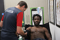 Pictured: Wilfried Bony is examined by team doctor Jez McCluskey during his medical at the Fairwood Training Ground, Wales, UK. Thursday 31 August 2017<br /> Re: Wilfried Bony has signed a contract with Swansea City FC.
