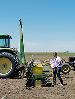 Nolan Thompson with Thompson Farms, plants corn near Holly, Colorado, Friday, May 20, 2016. Thompson Farms, a large farming operation, hold junior water rights to irrigate with water diverted from the Arkansas River through the Amity Canal.<br /> <br /> Photo by Matt Nager