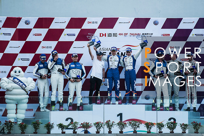 Oreca 03R Nissan's drivers Ho-pin Tung and Gustavo Menezes of Jackie Chan DC Racing celebrate the victory of LMP2 Class during the 2016-2017 Asian Le Mans Series Round 1 at Zhuhai Circuit on 30 October 2016, Zhuhai, China.  Photo by Marcio Machado / Power Sport Images