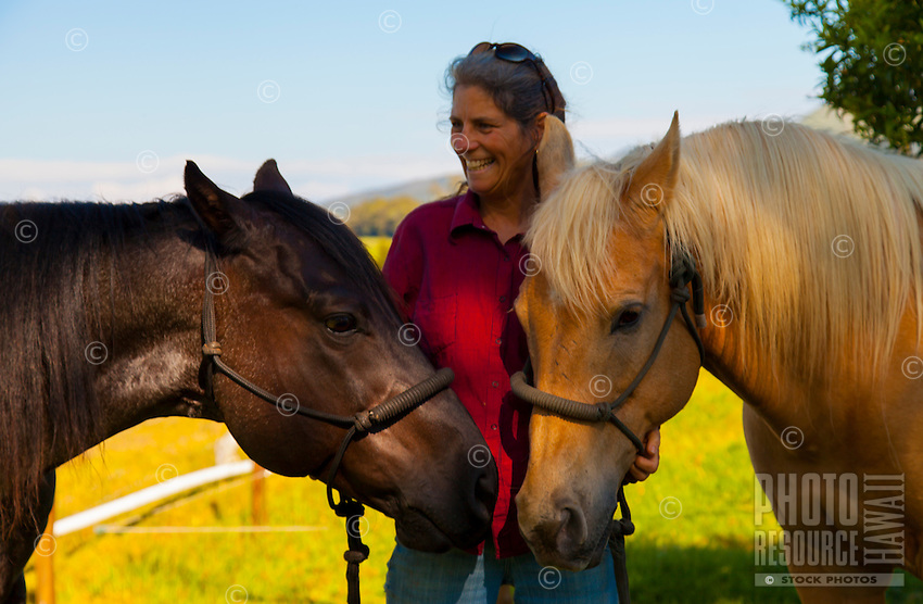 Two happy Waimea horses showing trust and friendship with their cowgirl in Waimea, Big Island.