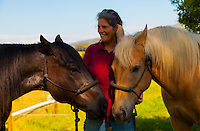 Two happy Waimea horses showing trust and friendship with their cowgirl in Waimea, Big Island.