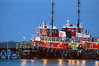 Two bright red tugboats.