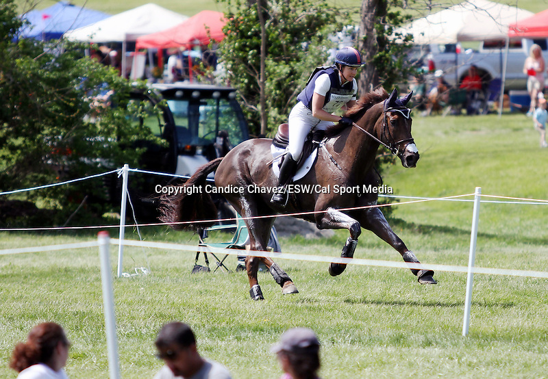 April 26, 2014: Arthur and Allison Springer compete in Cross Country at the Rolex Three Day Event in Lexington, KY at the Kentucky Horse Park.  Candice Chavez/ESW/CSM