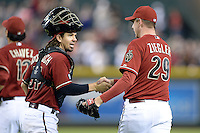 Arizona Diamondbacks catcher Tuffy Gosewisch (54) shakes hands with closer Brad Ziegler (29) after the last game of the season against the Washington Nationals at Chase Field on September 29, 2013 in Phoenix, Arizona.  Arizona defeated Washington 3-2.  (Mike Janes/Four Seam Images)