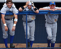 Fernandina beach players #16 Doug Walker (left), #10 Lee Steger (center) and #21 Ryan Estes have anguished faces as the Pirates had two outs in their final at-bat down 2-0.