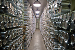 Ice core samples stacked in the National Ice Core Laboratory's freezer.  The samples are stored at -36 degrees Farenheit...National Ice Core Laboratory, Lakewood, Colo.  Photographs from inside the laboratory and its storage space.  Ice core samples are drilled and transported from ice sheets in Greenland and Anarctica and transportd to the Ice Core Lab for processing and distribution to laboratories that have received grants from the National Science Foundation.  Because the cores trap greenhouse gas and ash samples, climate scientists can extract data about the Earth's climate from upwards of 400,000 years ago.  Samples are packed in silver tubes, placed in insulated boxes, and shipped from the ice caps in refrigerated cargo containers; the storage space is kept at -36 degrees Farenheit.