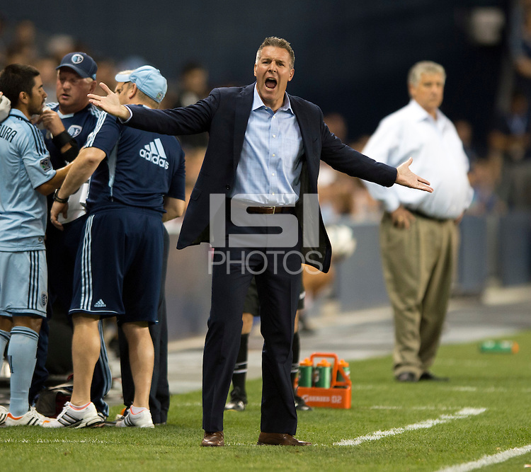 Sporting Kansas City head coach Peter Vermes questions a call during the game at Livestrong Sporting Park in Kansas City, Kansas.   Sporting Kansas City won the Lamar Hunt U.S. Open Cup on penalty kicks after tying the Seattle Sounders in overtime.