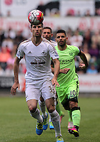 ( L-R ) Federico Fernandez of Swansea City against Sergio Aguero of Manchester City during the Swansea City FC v Manchester City Premier League game at the Liberty Stadium, Swansea, Wales, UK, Sunday 15 May 2016