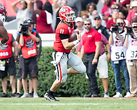 ATHENS, GA - OCTOBER 12: Jake Fromm #11 of the Georgia Bulldogs is flushed from the pocket and runs with the ball during a game between University of South Carolina Gamecocks and University of Georgia Bulldogs at Sanford Stadium on October 12, 2019 in Athens, Georgia.