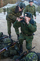 Kamenka, Karelia, Russia, 14/12/2007..Professional Russian soldiers inspect their Swedish counterparts' kit during Snezhinka [Snowflake] 2007, a joint live fire training exercise for Russian and Swedish motorised infantry in which they play the roles of a combined peace-keeping force enforcing a demilitarised zone in a warring region.