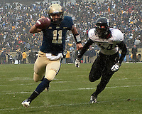 Pittsburgh quarterback Bill Stull (11) scores on a 3-yard touchdown run. The Cincinnati Bearcats defeated the Pittsburgh Panthers 45-44 in the final seconds of the River City Rivalry in a contest for the Big East Championship and a major bowl bid on December 5, 2009 at Heinz Field, Pittsburgh, Pennsylvania. .