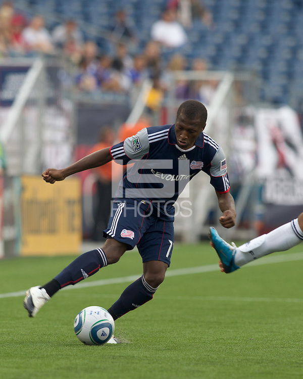 New England Revolution midfielder Sainey Nyassi (17) dribbles under pressure. The Chicago Fire defeated the New England Revolution, 1-0, at Gillette Stadium on June 27, 2010.