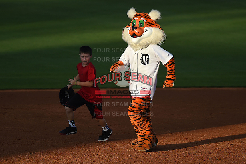 Lakeland Flying Tigers mascot participates in a base race with a young fan during a game against the Tampa Yankees on April 5, 2014 at Joker Marchant Stadium in Lakeland, Florida.  Lakeland defeated Tampa 3-0.  (Mike Janes/Four Seam Images)