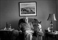 **FOR SYLVA COLUMN**.Ramon Lujan (cq), 83, sits in his Hood home with his dog, Lovey (cq). Photo taken Thursday, January 14, 2007. Sacramento Bee/ Kevin German