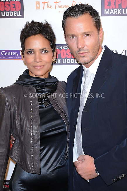 """WWW.ACEPIXS.COM . . . . . ....November 16 2009, New York City....Actress Halle Berry and photographer Mark Liddell arriving at """"An Evening of Awareness"""" at the Crosby Street Hotel on November 16, 2009 in New York City.....Please byline: KRISTIN CALLAHAN - ACEPIXS.COM.. . . . . . ..Ace Pictures, Inc:  ..tel: (212) 243 8787 or (646) 769 0430..e-mail: info@acepixs.com..web: http://www.acepixs.com"""