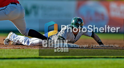 8 July 2012: Vermont Lake Monsters infielder Jacob Tanis dives safely back to first during game action against the State College Spikes at Centennial Field in Burlington, Vermont. The Lake Monsters rallied from a 2-0 late inning deficit, to defeat the Spikes 8-2 in NY Penn League action. Mandatory Credit: Ed Wolfstein Photo