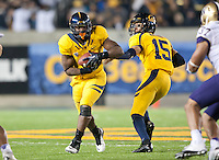 November 2nd, 2012: California's C.J. Anderson is being handed off by Zach Maynard during a game against Washington at Memorial Stadium, Berkeley, Ca Washington defeated California 21 -13