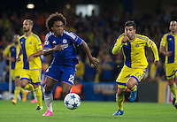 Willian of Chelsea & Avi Rikan of Maccabi Tel Aviv chase down the ball during the UEFA Champions League match between Chelsea and Maccabi Tel Aviv at Stamford Bridge, London, England on 16 September 2015. Photo by Andy Rowland.