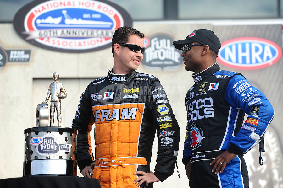 Nov. 13, 2011; Pomona, CA, USA; NHRA top fuel dragster driver Antron Brown (right) and Spencer Massey with the 2011 championship trophy during the Auto Club Finals at Auto Club Raceway at Pomona. Mandatory Credit: Mark J. Rebilas-.