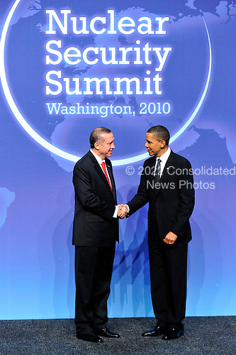 United States President Barack Obama welcomes Prime Minister Recep Tayyip Erdogan of Turkey to the Nuclear Security Summit at the Washington Convention Center, Monday, April 12, 2010 in Washington, DC. .Credit: Ron Sachs / Pool via CNP