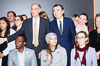 Philippe Douste-Blazy (center right) and professor Rifat Atun (left) pose for portraits with a group of mostly Harvard graduate students after a lunch-time conversation during a visit to Harvard University's T. H. Chan School of Public Health in Boston, Massachusetts, USA. Atun is the director of the Global Health Systems Cluster and a Professor of Global Health Systems at the School of Public Health. The visit is part of his campaign to become Director General of the World Health Organization. During the visit, he met with professors, students, and visiting scholars, including former Ministers of Health from England and Brazil. Doutse-Blazy is Under-Secretary-General and Special Adviser on Innovative Financing for Development in the United Nations and chairman of UNITAID. He served as Minister of Health, Minister of Culture, and Foreign Minister in the French government and was also mayor of Lourdes and Toulouse.