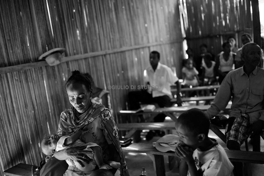 """MADAGASCAR, AMBANJA, AUGUST 2013: <br />Radison Bienvenue, chief of security of the CINA cocoa plantation, was Murder the 12th of March 2013, the whole village tight around his wife at his funeral.<br />Madagascar is home to some of the world's finest rich orange and red pods of cocoa, increasingly used today by Europe and America's finest chocolatiers.Raw cocoa beans, used to make premium chocolate, have never been in higher demand. A surge in appetite for high-end chocolate sourced from single-origin growers has created a frenzied rush for the """"dark gold"""".<br /> For the island's cocoa farmers, the surging demand for chocolate should be transformative, especially after years of poverty, but their newfound livelihoods are under threat from armed bandits running rampant in remote areas, hijacking stores and road shipments of the precious beans that make chocolate. © Giulio Di Sturco"""