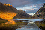 Glencoe, Scotland:<br /> Evening light plays on the Highlands around Glencoe with reflections on the River Coe
