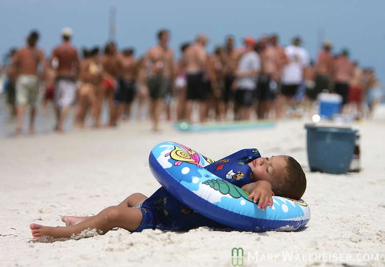 "Matthew Harrelson, a 2 year-old from Carrabelle, takes a break from his Memorial Day weekend at the White Trash Bash at Dog Island off the coast of Carrabelle Sunday May 27, 2007.  ""We came over yesterday and camped out"" said his mother Niki Kennedy.(Photo by Mark Wallheiser/TallahasseeStock.com)  (Mark Wallheiser/TallahasseeStock.com)"