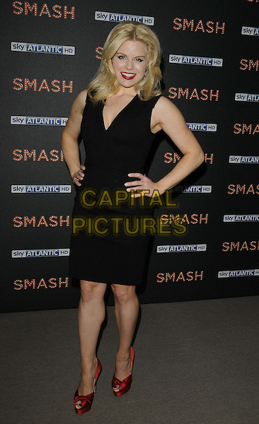 Megan Hilty.The 'SMASH' photocall to promote this brand new musical drama beginning on the Sky Atlantic HD channel in April 2012, The Soho Hotel, Richmond Mews. London, England..April 2nd, 2012.full length black dress hands on hips red shoes .CAP/CAN.©Can Nguyen/Capital Pictures.