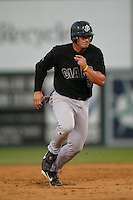 Brian Buscher of the San Jose Giants runs the bases during a 2004 season California League game against the Inland Empire 66ers at San Manuel Stadium in San Bernardino, California. (Larry Goren/Four Seam Images)