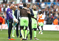 Manchester City manager Manuel Pellegrini hugs Yaya Toure at full time during the Barclays Premier League match between Swansea City and Manchester City played at The Liberty Stadium, Swansea on 15th May 2016
