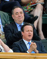 OIC - ENTSIMAGES.COM -  Alex Salmond  and David Cameron watch Andy Murray of Great Britain celebrates his win in the Gentlemen's Singles Final match against Novak Djokovic of Serbia of the Wimbledon Lawn Tennis Championships at the All England Lawn Tennis and Croquet Club 7th July 2013     Photo Ents Images/OIC 0203 174 1069