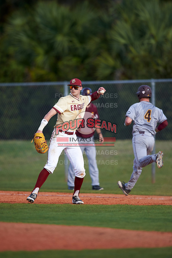 Boston College Eagles first baseman Mitch Bigras (4) throws the ball around after forcing out Blake Cleveland (4) in the bottom of the ninth inning during a game against the Central Michigan Chippewas on March 3, 2017 at North Charlotte Regional Park in Port Charlotte, Florida.  Boston College defeated Central Michigan 5-4.  (Mike Janes/Four Seam Images)