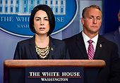 Assistant Director Barbara M. Gonzalez, United States Immigration and Customs Enforcement, left, makes remarks as acting Director, US Immigration and Customs Enforcement (ICE) Matthew Albence, right, listens as they brief reporters in the Brady Briefing Room of the White House in Washington, DC on Thursday, October 10, 2019.<br /> Credit: Ron Sachs / CNP