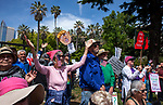 About a thousand people marched from Southside Park to the State Capitol Building in Sacramento, California on Saturday, April 15, 2017 for The National Tax March.  The march is to protest President Donald Trump's refusal to release the records of his tax returns.  The crowd assembled at Southside Park and marched through the city streets to the Capitol Mall for an assembly of performances, music, and speakers.  Photos/Victoria Sheridan 2017