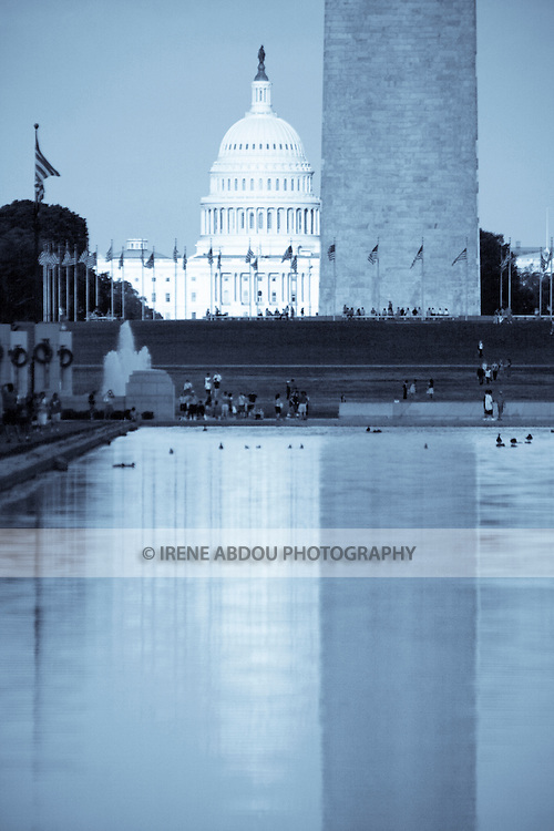 The U.S. Capitol and Washington Monument are reflected in the Reflecting Pool.