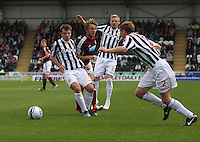 Paul McGowan, Gary Teale and David van Zanten combine to thwart Arvydas Novikovas in the St Mirren v Heart of Midlothian Clydesdale Bank Scottish Premier League match played at St Mirren Park, Paisley on 15.9.12.
