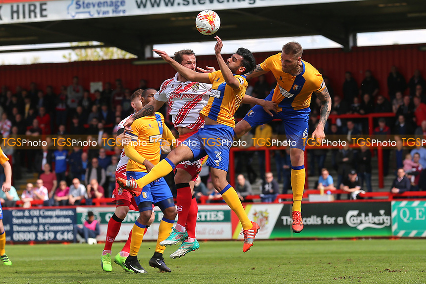 Luke Wilkinson of Stevenage rises with Malvind Benning of Mansfield Town during Stevenage vs Mansfield Town, Sky Bet EFL League 2 Football at the Lamex Stadium on 22nd April 2017