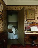 A bed set into a cupboard in the parlour found only in houses built before 1900, banned thereafter on health grounds *** Local Caption *** National Trust for Scotland