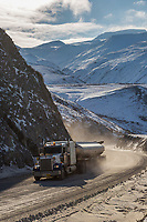 Trucker hauls supplies on the James Dalton Highway, Arctic, Alaska.