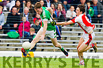 Conor Keane Legion in action against Cathal Murphy Rathmore in the semi-final of the County Senior Football Championship at Fitzgerald Stadium on Sunday.