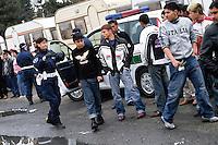 Milano, Campo nomadi di via Triboniano, la polizia municipale all'interno del campo..- Milan, Roma gypsies camp in Triboniano street, municipal police in the camp