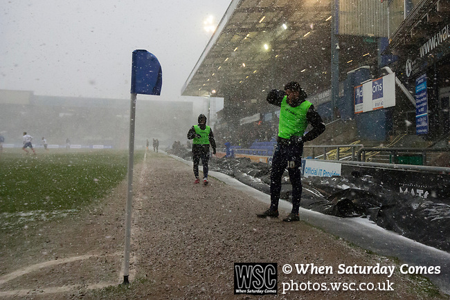 Aaron Holloway of Oldham tshields his eyes from the snow. Oldham v Portsmouth League 1