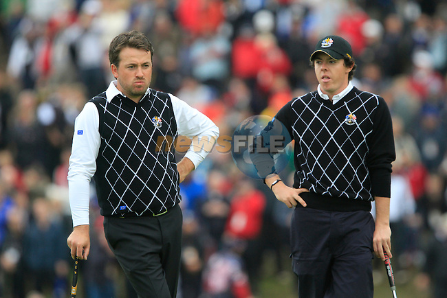 Graeme McDowell and Rory McIlroy wait on the 17th green in the Session 2 Foursomes Match 6 during Day 2 of the The 2010 Ryder Cup at the Celtic Manor, Newport, Wales, 2nd October 2010..(Picture Eoin Clarke/www.golffile.ie)