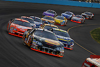 Apr 22, 2006; Phoenix, AZ, USA; Nascar Nextel Cup driver Martin Truex Jr. of the (1) Bass Pro Shops Chevrolet Monte Carlo leads a pack of cars during the Subway Fresh 500 at Phoenix International Raceway. Mandatory Credit: Mark J. Rebilas-US PRESSWIRE Copyright © 2006 Mark J. Rebilas..