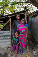 Bangladesh, Jhenaidah. Neema and her husband are caretakers for the public toilets in the local market. She collects the money and he cleans them. They collect 2 TK each for about 100 customers a day so they make about 200 TKs or $2 a day. they live in a local slum and have one daughter. He tends to take the money and drink.  Most of these people living in this slum are Dalit Hindu, or the untouchable caste working as sweepers and toilet cleaners. There are about 5.5 million Dalit across the country, they are most neglected caste in their society. The SNV Development Organization is providing fecal sludge management and occupational safety training for toilet and septic tank cleaners. At their home.  Model released.