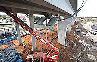 Dallas Area Rapid Transit workers built a new light rail transit stop for the new Green Line in Carrollton, Texas, USA, Thursday, Dec., 3, 2009. The City of Dallas hopes plans to open the new line in 2010...MATT NAGER/ BLOOMBERG NEWS