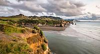 Sunset on coastline with Three Sisters rock formation and Tongaporutu River near Taranaki, New Plymouth, Taranaki Region, North Island, New Zealand, NZ
