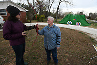 NWA Democrat-Gazette/J.T. WAMPLER  Kathy Skaggs of Elkins instructs Sarah Heiser (LEFT) of Bentonville how to shoot a bow Sunday March 25, 2018 in Fayetteville during  the 10th Annual Fayetteville Goddess Festival. The festival wrapped up Sunday.